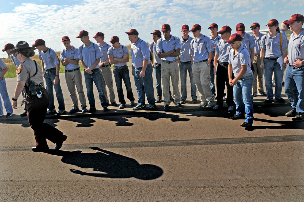 . Minnesota State Patrol Tech Sergeant Kelly Phillips, left, analyzes a skid mark as she shows the cadets how crash reconstructionists calculate the speeds of vehicles involved in serious or fatal crashes. (Pioneer Press: Jean Pieri)