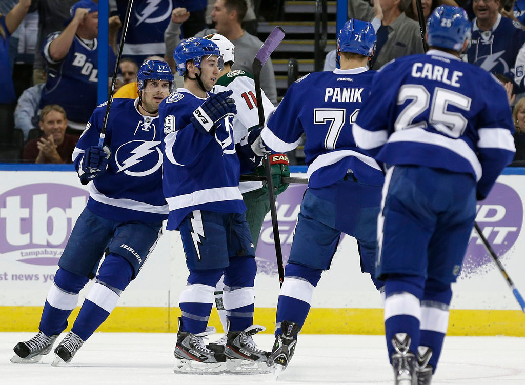 . Tampa Bay Lightning center Tyler Johnson (9) celebrates with teammates Alex Killorn (17), Richard Panik (71), of Slovakia, and Matt Carle (25) after scoring against the Minnesota Wild during the first period. (AP Photo/Chris O\'Meara)