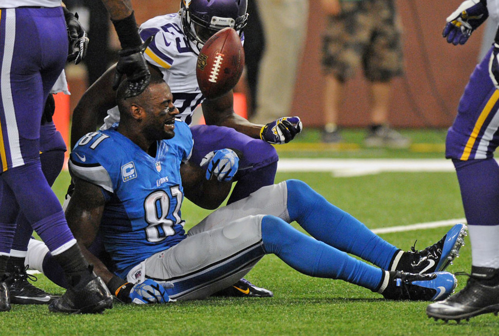 . Lions wide receiver Calvin Johnson lost his helmet after a reception in the fourth quarter. Guarding him was Vikings cornerback Xavier Rhodes, background.  (Pioneer Press: Chris Polydoroff)