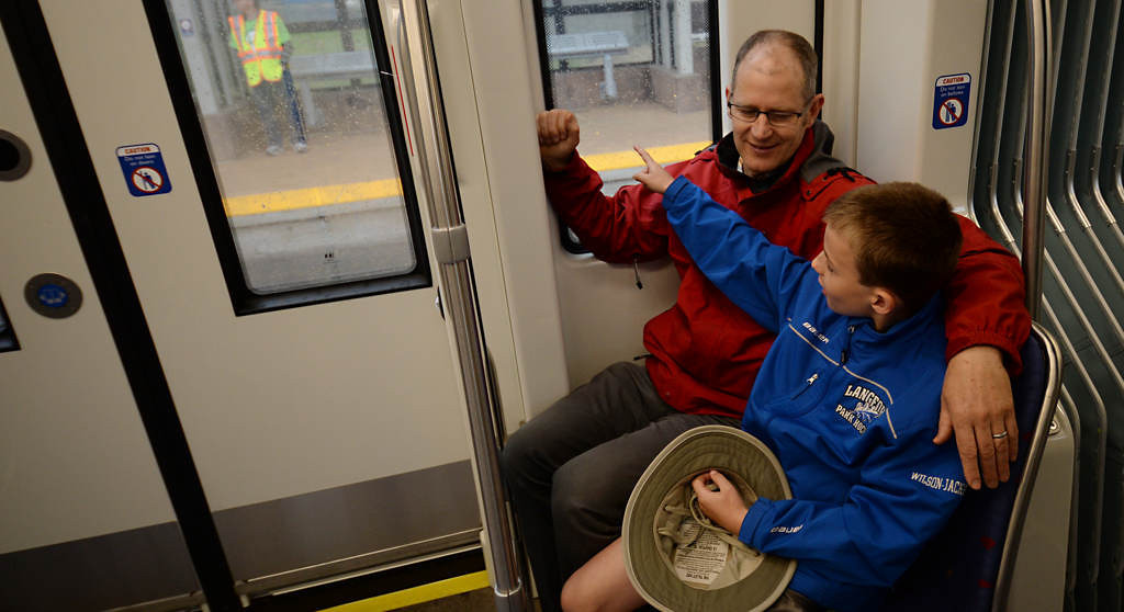 . Charlie Wilson-Jackson, 11 years-old, and his dad Ross Jackson enjoy their seats on the Green Line train during the Metro Transit Green Line Grand Opening. (Pioneer Press: John Autey)