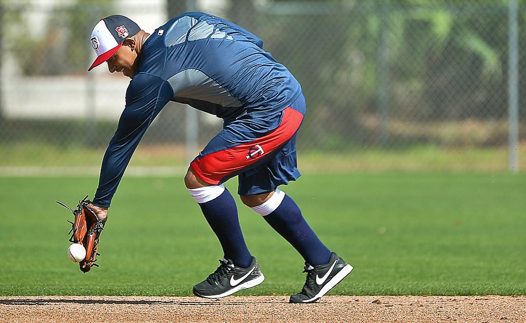 . Twins shortstop Eduardo Escobar boots a grounder during an infield workout. (Pioneer Press: Ben Garvin)