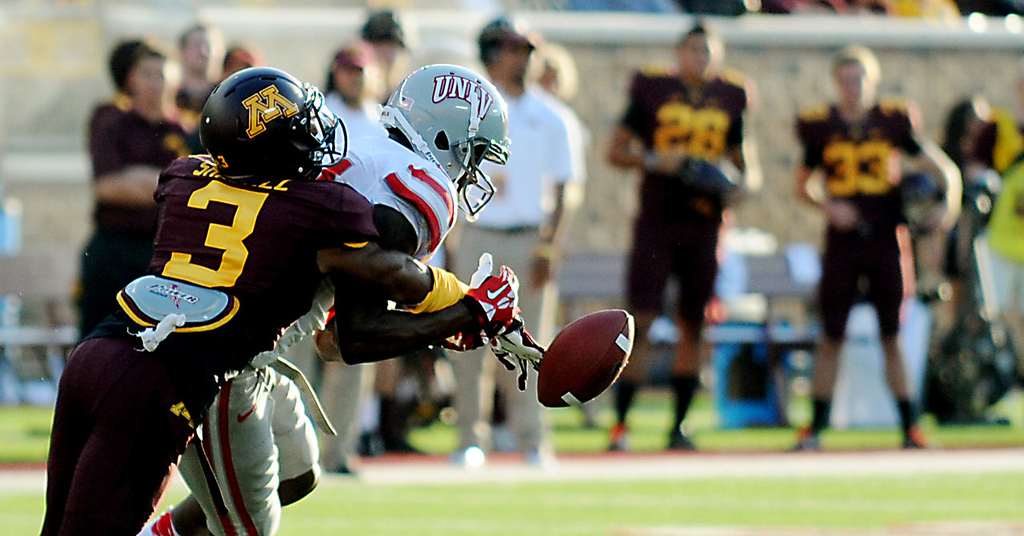 . Minnesota defensive back Martez Shabazz breaks up a pass intended for UNLV wide receiver Maika Mataele during the second quarter. (Pioneer Press: John Autey)