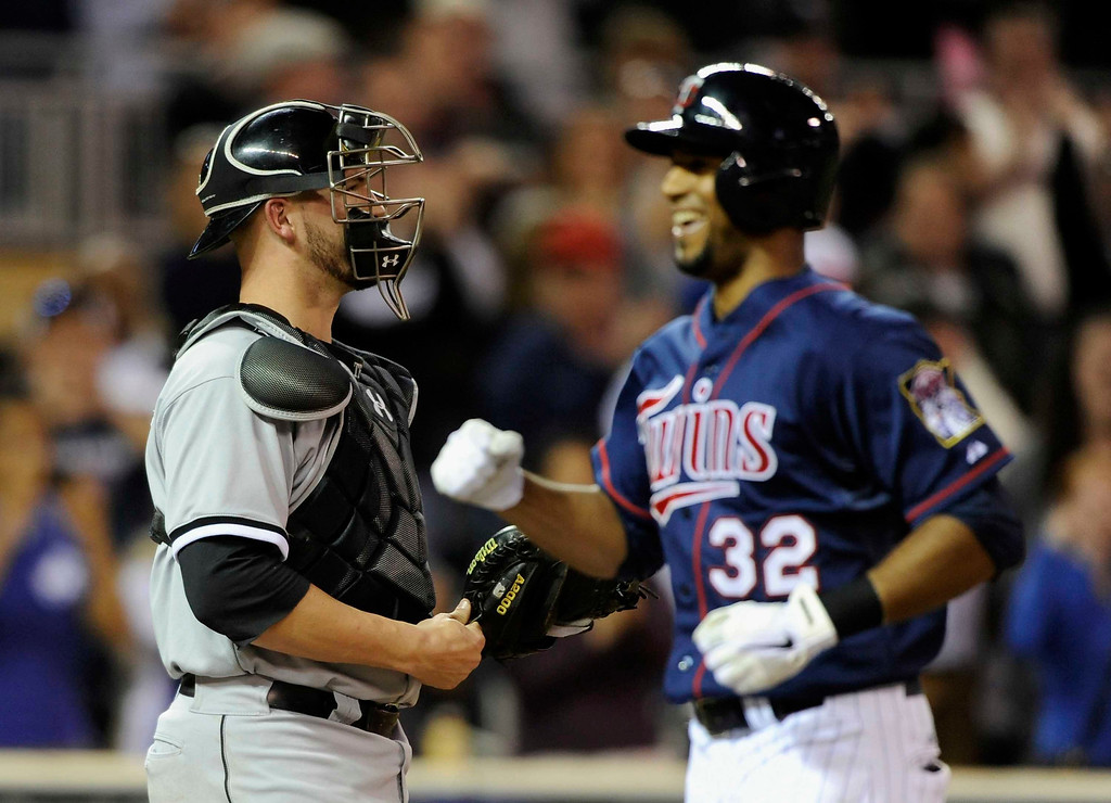. ChiSox catcher Tyler Flowers looks on as Minnesota\'s Aaron Hicks crosses home plate after hitting a solo home run during the sixth inning of the game on May 13, 2013 at Target Field in Minneapolis, Minnesota. (Photo by Hannah Foslien/Getty Images)