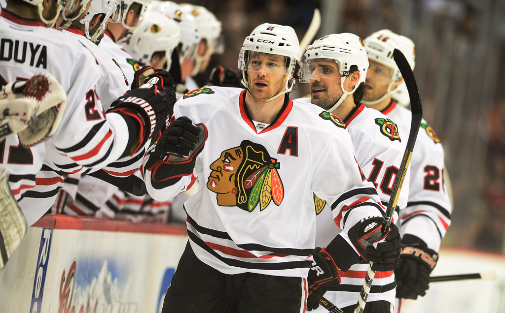 . Chicago defenseman Duncan Keith skate past the bench after teammate Patrick Sharp (behind Keith) scored in the the first period against the Wild.  (Pioneer Press: Ben Garvin)