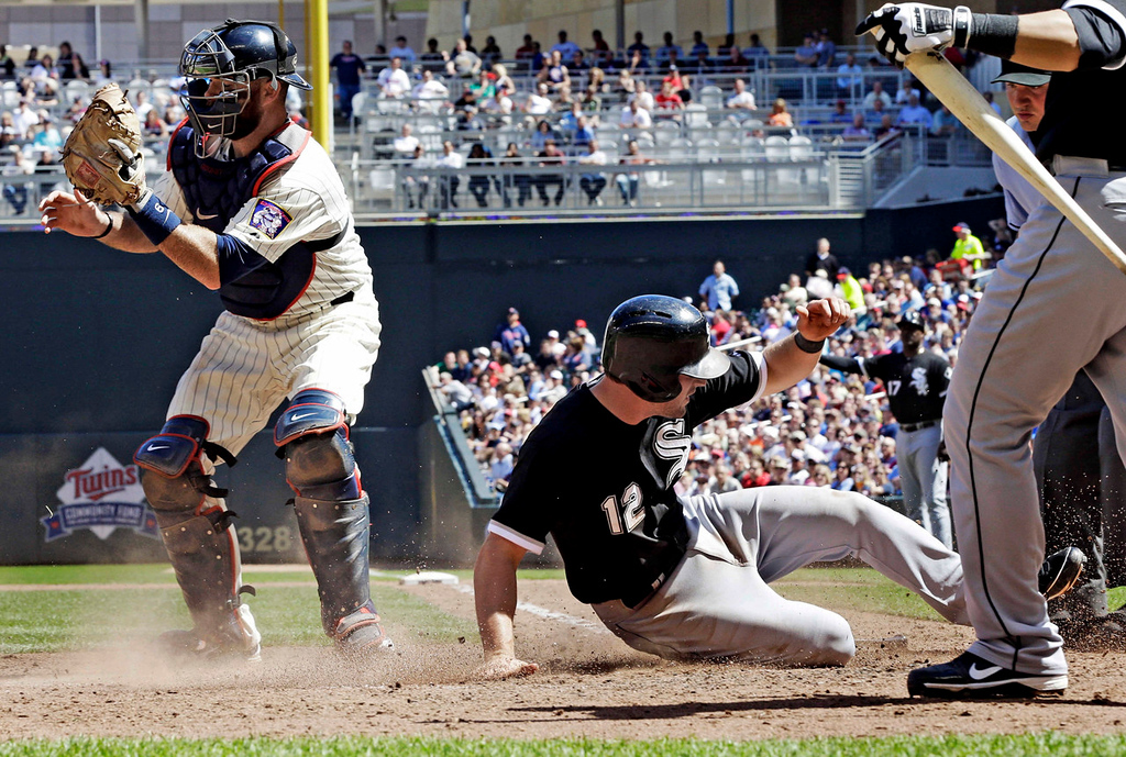 . Twins catcher Ryan Doumit waits for the throw as Chicago\'s Conor Gillaspie scores on a two-run double by Jeff Keppinger in the seventh inning. (AP Photo/Jim Mone)