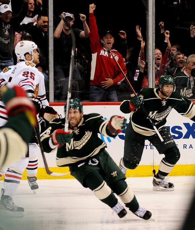 . Minnesota left wing Jason Zucker celebrates his overtime goal against Chicago. (Pioneer Press: John Autey)