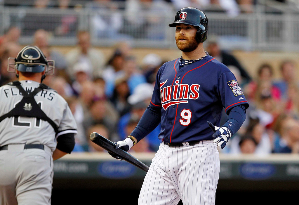 . Minnesota Twins designated hitter Ryan Doumit (9) reacts after striking out against Chicago White Sox starting pitcher Hector Santiago during the first inning of a baseball game, Monday, May 13, 2013, in Minneapolis. (AP Photo/Genevieve Ross)