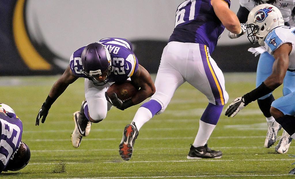. Minnesota Vikings running back Joe Banyard stumbles as he hits a hole in the line during the fourth quarter against the Titans.  (Pioneer Press: Sherri LaRose-Chiglo)