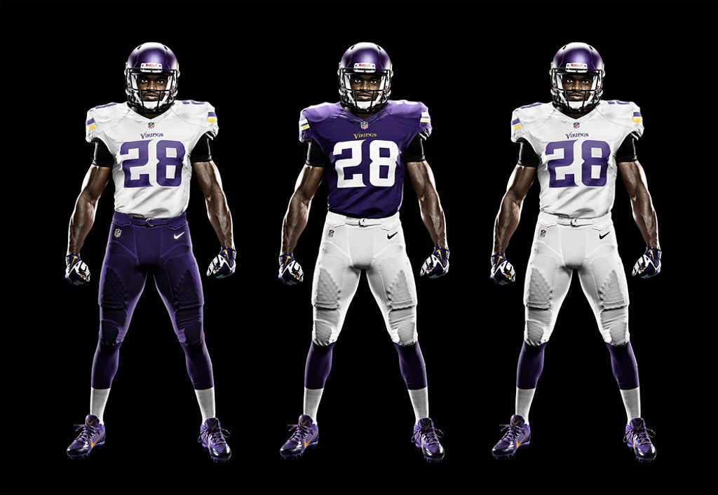. Adrian Peterson models three of the four Vikings uniform combinations. Not shown is the purple pants/purple jersey option. (AP Photo/Minnesota Vikings)