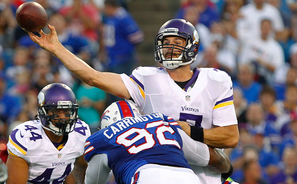 . Minnesota Vikings\' Christian Ponder is hit by Buffalo Bills\' Alex Carrington (92) and Manny Lawson (91) while throwing the ball during the first half of an NFL preseason football game Friday, Aug. 16, 2013, in Orchard Park, N.Y.  (AP Photo/Bill Wippert)