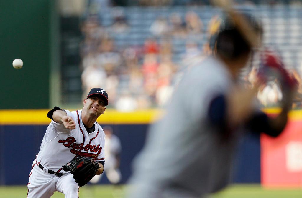 . Atlanta Braves starting pitcher Tim Hudson throws in the first inning. (AP Photo/John Bazemore)