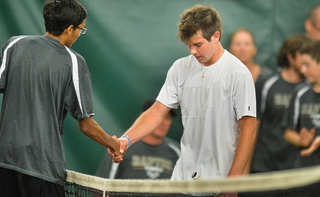 . Nikhil Gupta of East Ridge, left, shakes hands with Abraham Alex of Mounds View 7-6 (4), 6-4 in the State Class AA Boys\' Tennis Tournament team quarterfinals. (Pioneer Press: Ben Garvin)