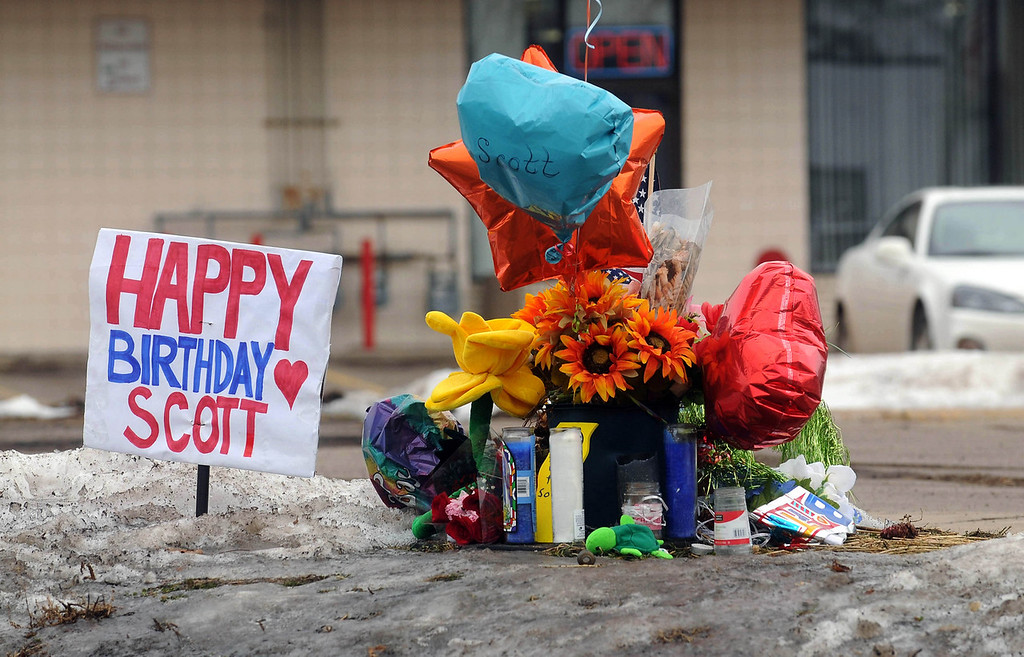 . Balloons, flowers and signs celebrate police officer Scott Patrick\'s birthday, which was Monday, January 26. The memorial marks the site where he was shot, near Smith Avenue and Dodd Road in West St. Paul, on Tuesday, January 27, 2015. (Pioneer Press: Scott Takushi)