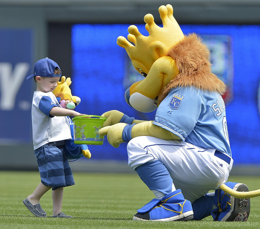 . Beckett Flannery, 4, from Maysville, Mo., gets a chance to find Easter eggs in the outfield, compliments of Kansas City Royals mascot Sluggerrr, before the game between the Royals and the Minnesota Twins at Kauffman Stadium in Kansas City. (John Sleezer/Kansas City Star/MCT)