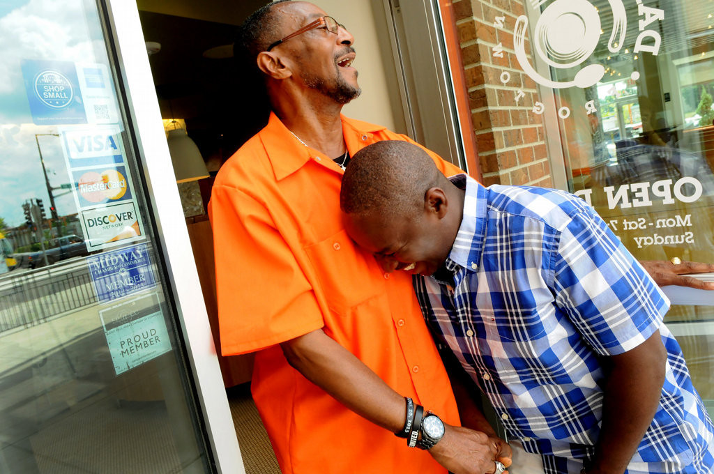 . Henry Wallace, left, says goodbye to Pastor Coolidge Dennis from Greater Grace International Church at Frogtown\'s Daily Diner after Dennis enjoyed a lunch at the diner. (Pioneer Press: Jean Pieri)