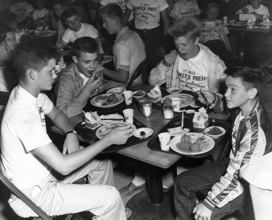 . St. Paul Dispatch and Pioneer Press boys out for a good time at Jack Robinson eat house at the Minnesota State Fair, Sept. 2, 1954. Lindsay Crocker, 15, Lakeland Minn.; Marcel Hoagland, 16, Lakeland Minn.; Gene Ermisch, 15, Lakeland Minn. and Walter Moechnig?, 13, Melville, Minn. Photo courtesy of the Minnesota State Fair.