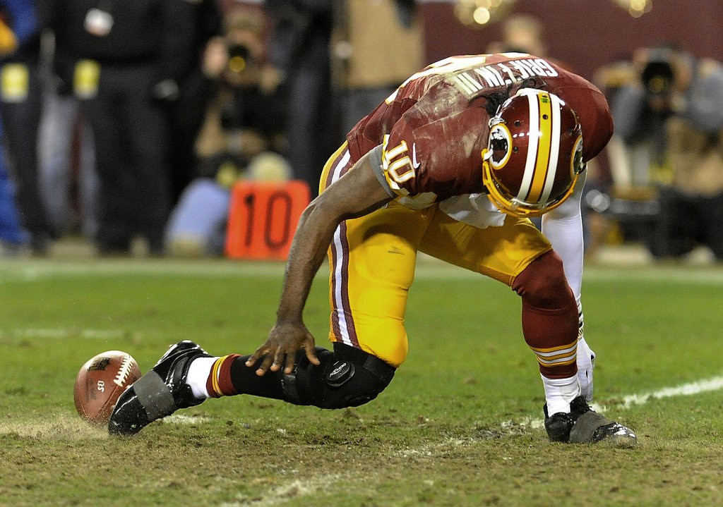 ". <p><b>WASHINGTON REDSKINS</b> <p><i>�BLOW, THIS JOINT�</i> <p>Mr. Griffin goes to Washington undaunted <p>One of the billion-dollar QBs <p>But the Skins will be far less than vaunted <p>Thanks to RGIII�s two-dollar knees <p><b><a href=\'http://espn.go.com/nfl/story/_/id/9616007/dr-james-andrews-concerned-how-robert-griffin-iii-used-washington-redskins\' target=""_blank\""> HUH?</a></b> <p>   (AP Photo/Richard Lipski, File)"