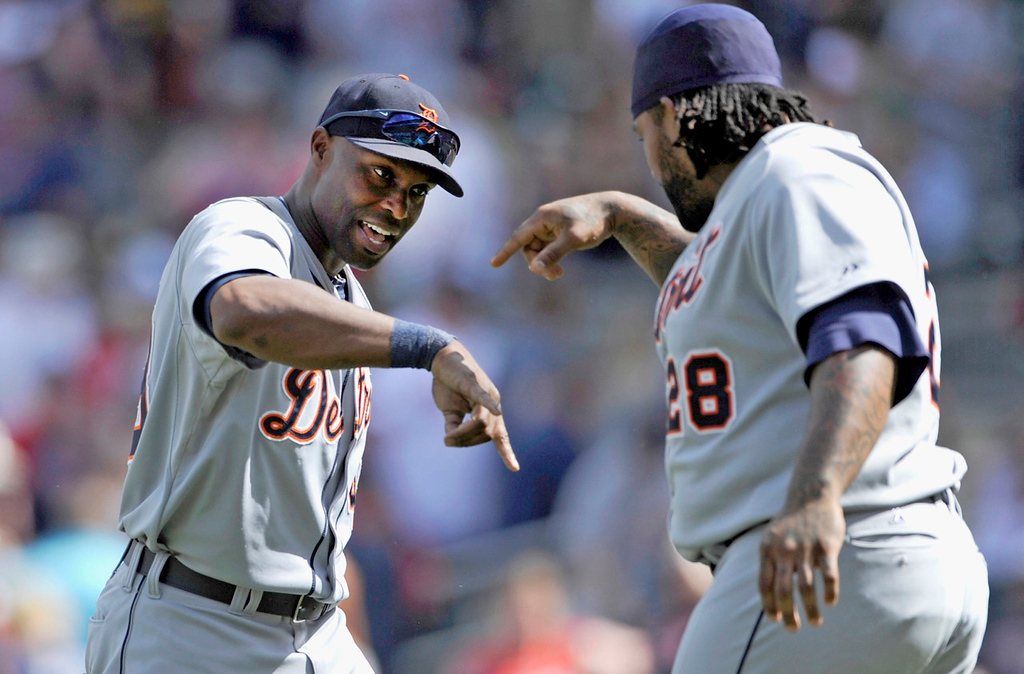 . Detroit\'s Torii Hunter, left, and Prince Fielder celebrate their 5-2 win over the Twins. (Photo by Hannah Foslien/Getty Images)
