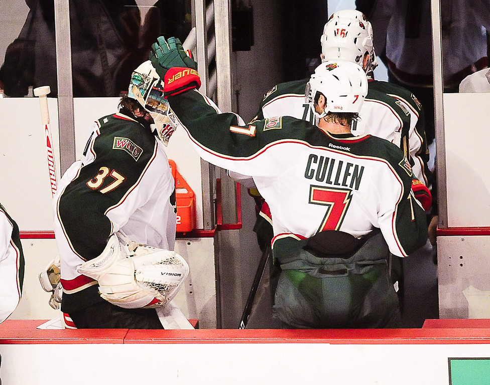 . The Wild\'s Matt Cullen greets Josh Harding as they leave the ice after losing 5-2 in Game 2. (Pioneer Press: Ben Garvin)