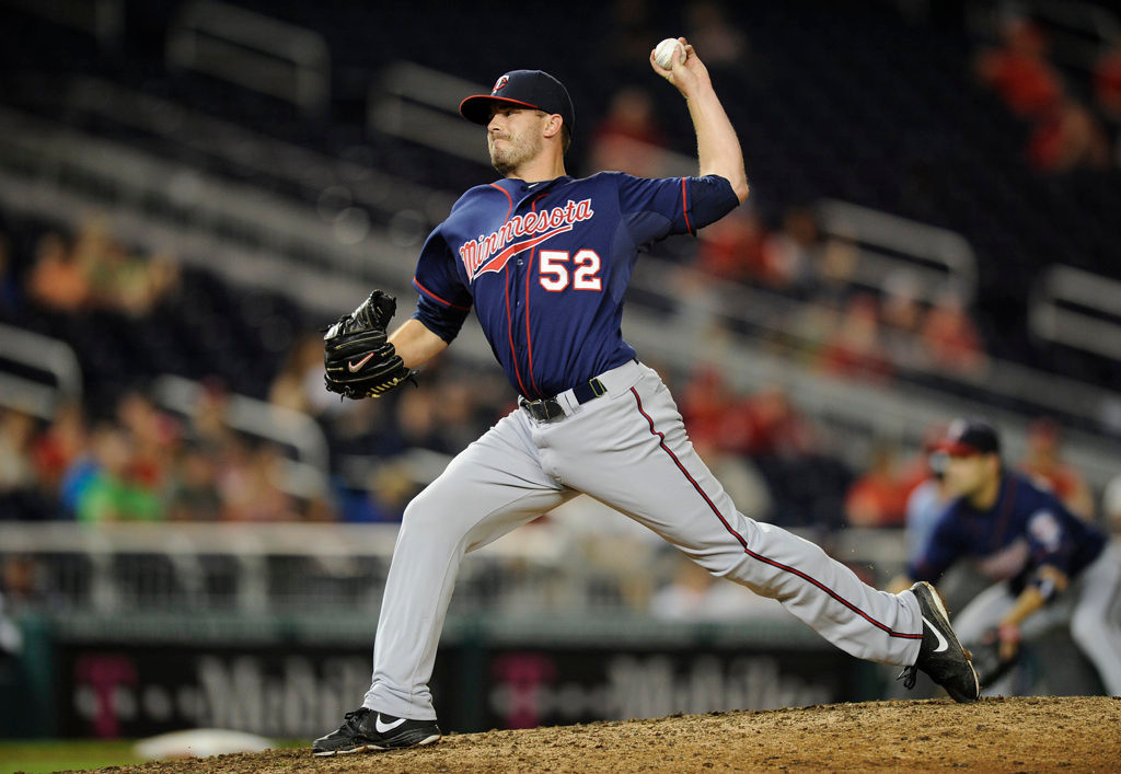 . Minnesota Twins relief pitcher Brian Duensing (52) delivers against the Washington Nationals during the eighth inning of the second baseball game of a day-night interleague doubleheader, Sunday, June 9, 2013, in Washington. The Nationals won 5-4. (AP Photo/Nick Wass)