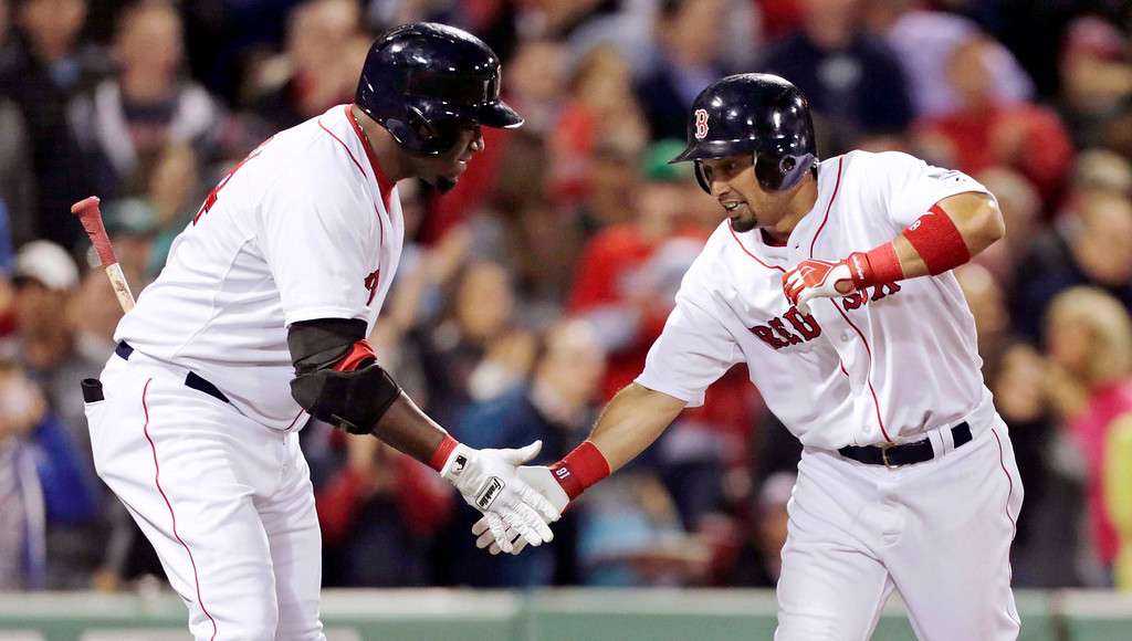 . Boston Red Sox\'s Shane Victorino, right, is congratulated by David Ortiz after his solo home run during the fourth inning. (AP Photo/Charles Krupa)