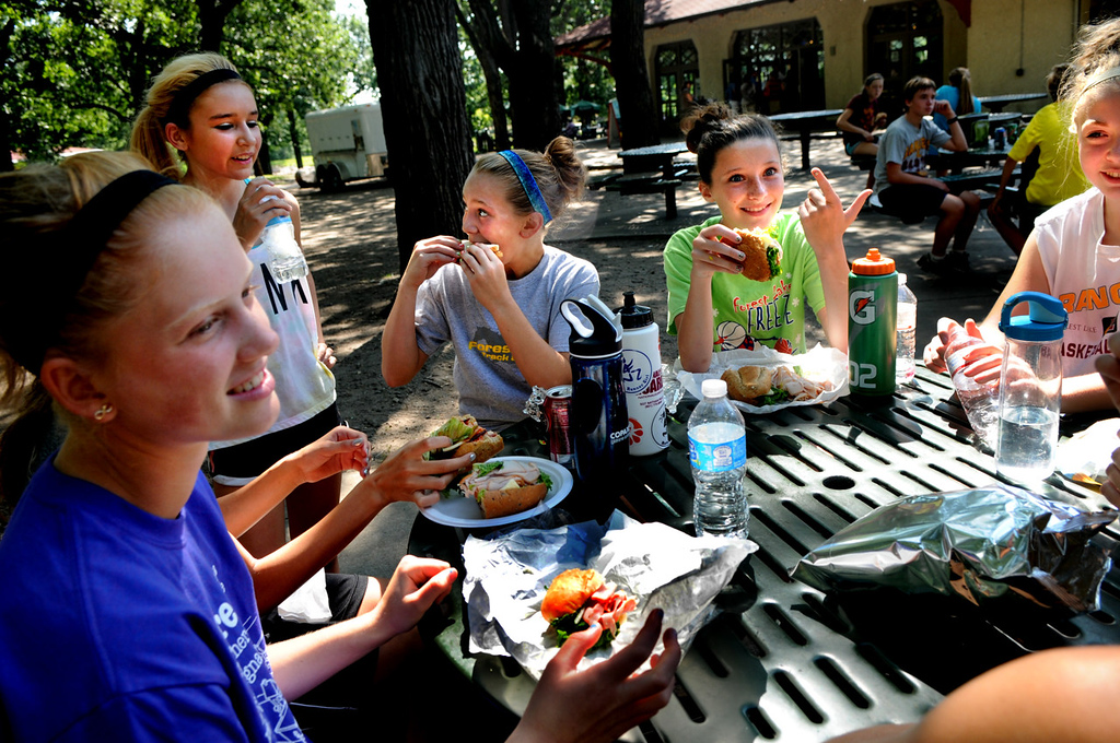 . At the end of practice, Forest Lake runners polish off a picnic lunch at Minnehaha Falls Park. From left: 8th grader Jessica Nieters, sophomore Kaylee Antrim, 8th grader Jenna Parent, 7th grader Jesseca Overland and sophomore Kyra Tietje. (Pioneer Press: Jean Pieri)