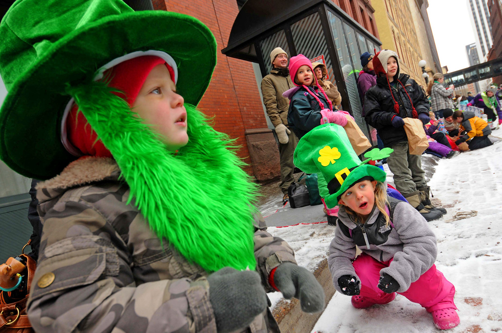 . Two-year-old Lowe Schulte, left, and his sister Ouest Schulte, 4, brave the snow and chill during thel St. Patrick\'s Day parade. (Pioneer Press: Scott Takushi)