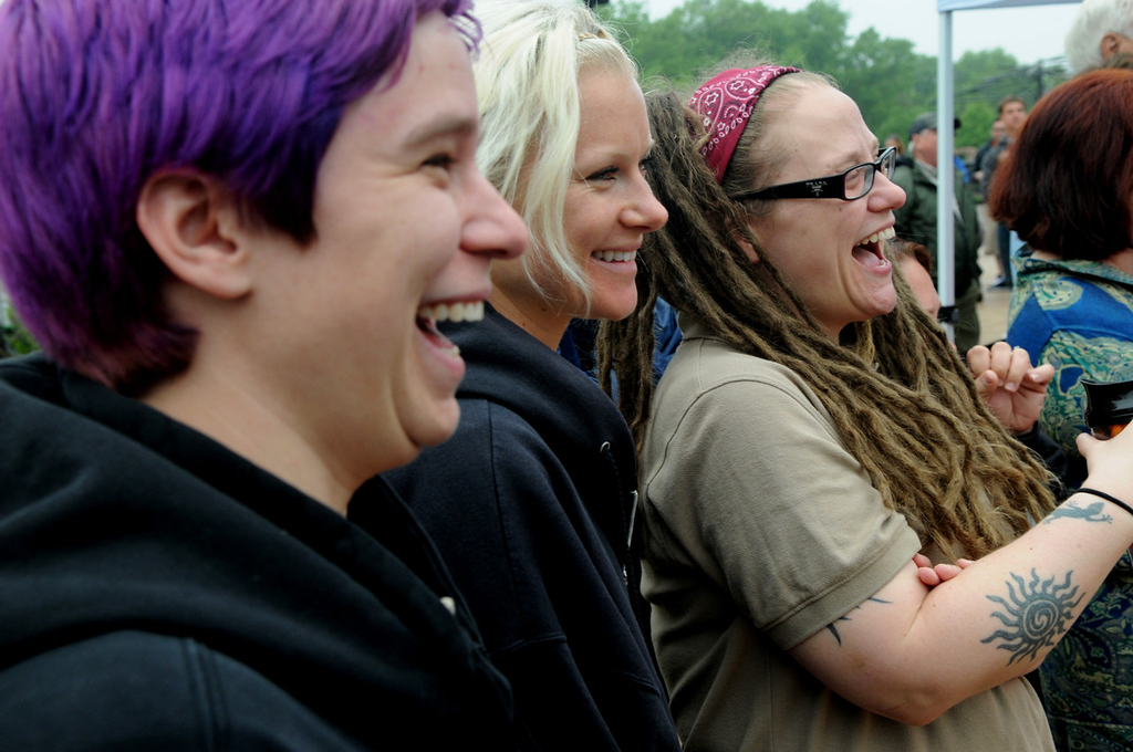 . Gorilla keepers, from left, Tami Murphy of Minneapolis, Bree Barney of St. Paul and Megan Elder of St. Paul laugh during opening ceremonies at Gorilla Forest. (Pioneer Press: Jean Pieri)