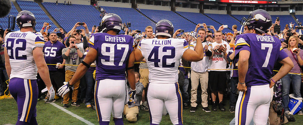 . Vikings players, from left, Kyle Rudolph, Everson Griffen, Jerome Felton and Christian Ponder model new Vikings uniforms during the Vikings Draft Party. (Pioneer Press: John Autey)