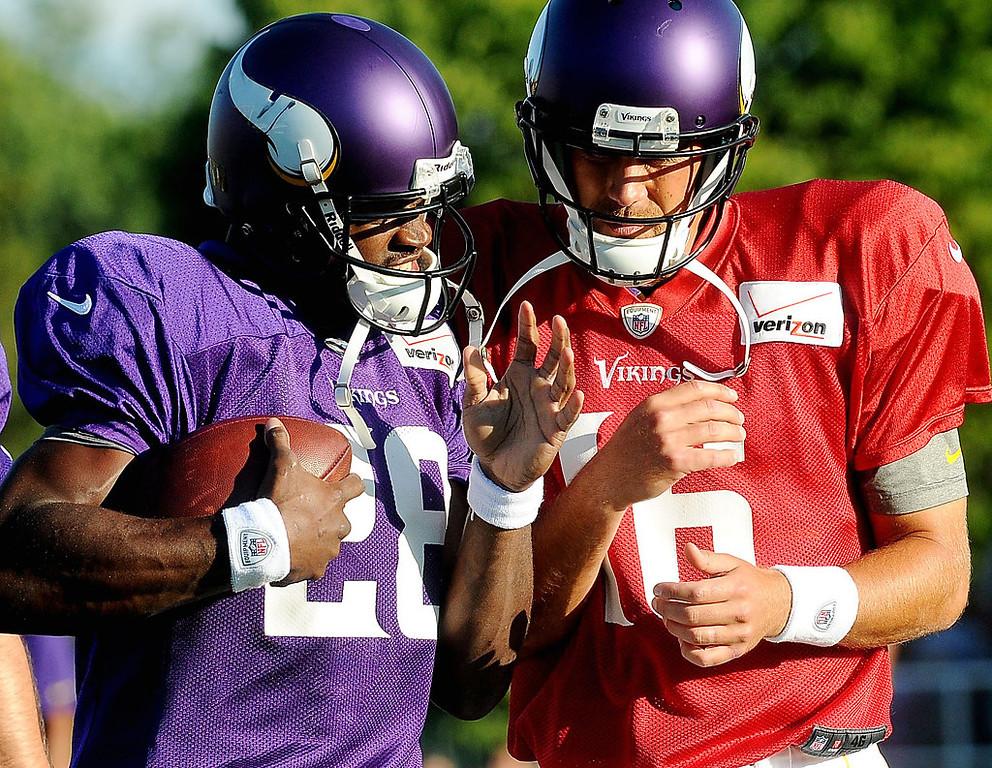 . Minnesota Vikings running back Adrian Peterson and quarterback Matt Cassell greet each other before the scrimmage. (Pioneer Press: Sherri LaRose-Chiglo)