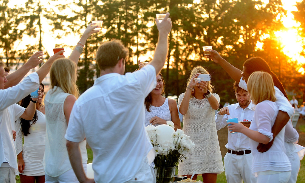 . Friends toast each other during the dinner. (Pioneer Press: Sherri LaRose-Chiglo)