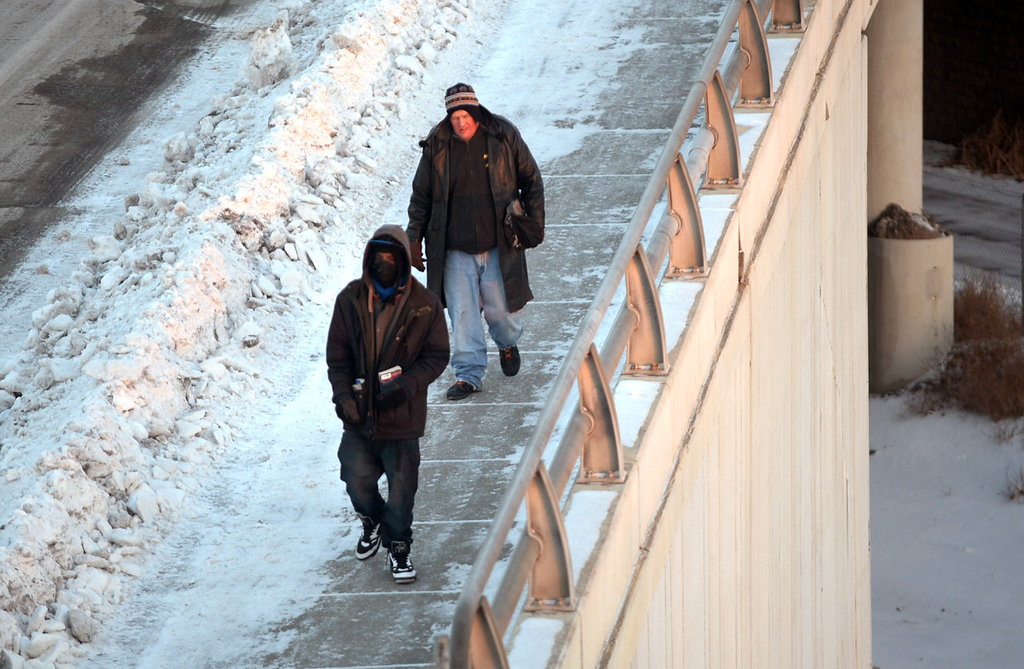 . Two men make their way down Glenwood Avenue to check in at the emergency shelter at Higher Ground in Minneapolis.  (Pioneer Press: Chris Polydoroff)