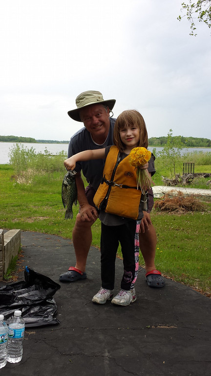 . Flowers and fish: Valarie Sutherland, 6, of Arden Hills, kept Grandpa Jim Mishek of north oaks busy on Memorial Day with this 13-inch crappie and other fish she caught on Chisago Lake.