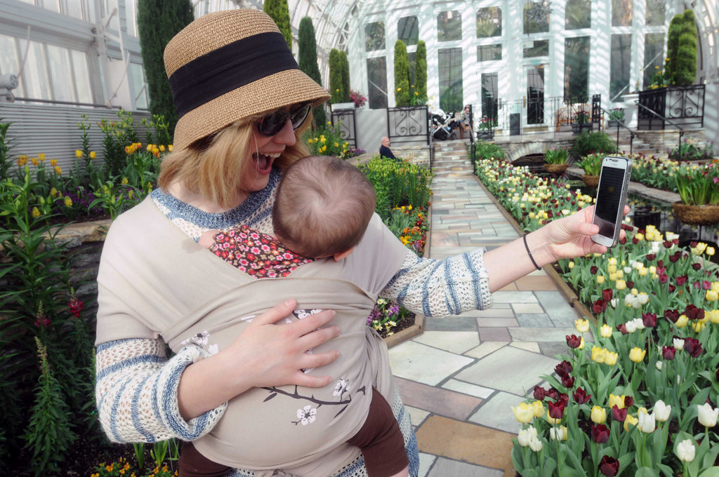. Holly Brown of Savage takes a selfie with her 8-month-old niece, Rosie Wilson, in the Sunken Garden at the Como Conservatory in St. Paul on Tuesday, March 25, 2014.  (Pioneer Press: Scott Takushi)