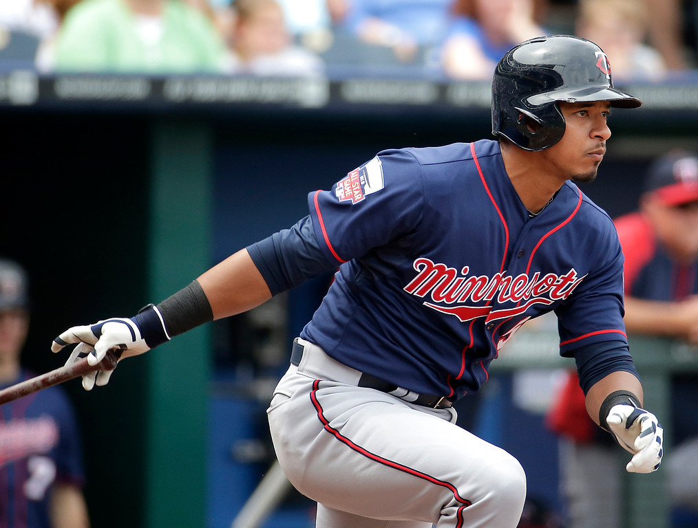 . Minnesota Twins\' Eduardo Escobar hits an RBI-single during the fourth inning. (AP Photo/Charlie Riedel)