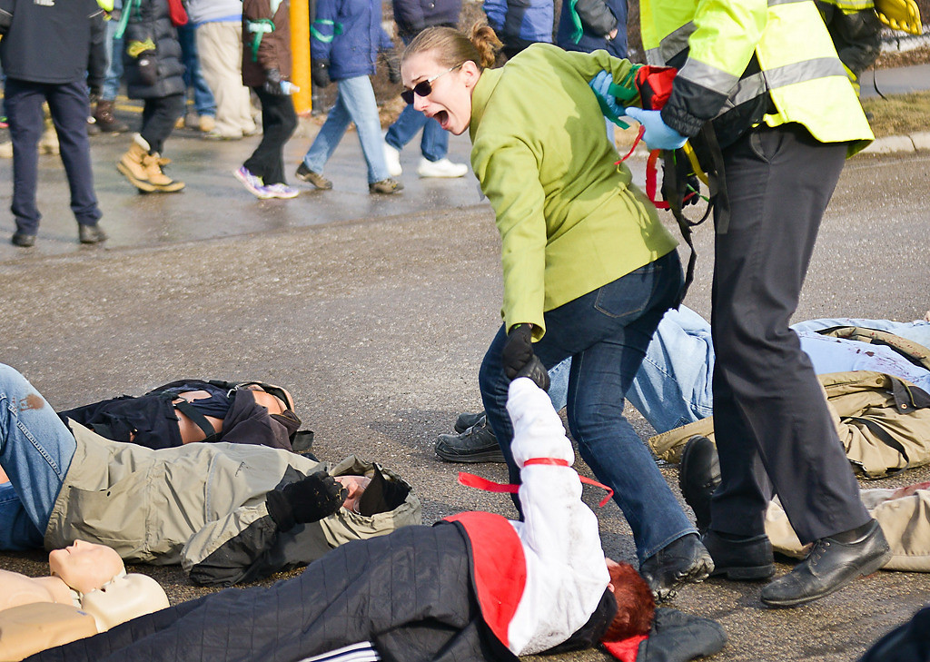 ". ""Mom!\"" yells a woman as she\'s dragged away from the triage area during a full-scale emergency preparedness exercise. (Pioneer Press: Ben Garvin)"