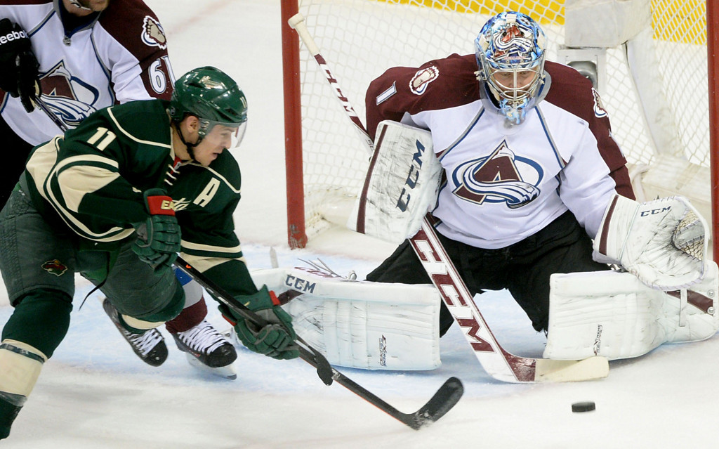 . The Wild\'s Zach Parise scores on Colorado Avalanche goaltender Semyon Varlamov during the first period.  (Pioneer Press: Sherri LaRose-Chiglo)