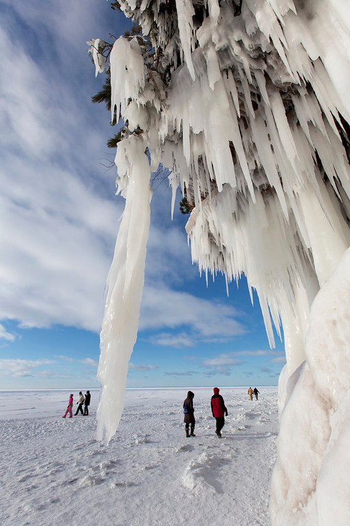 . Visitors walk along the icy cliffs of Lake Superior. (Pioneer Press: Andy Rathbun)