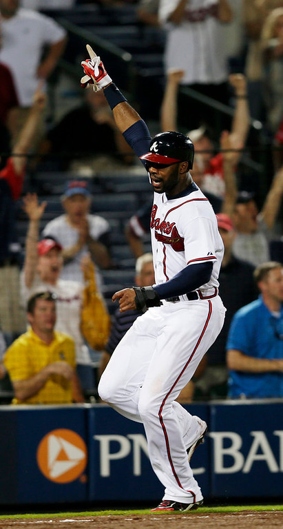 . Atlanta Braves right fielder Jason Heyward  reacts as he scores the game-winning run on a Freddie Freeman base hit in the 10th inning of a baseball game against the Minnesota Twins Tuesday, May 21, 2013 in  in Atlanta. (AP Photo/John Bazemore)