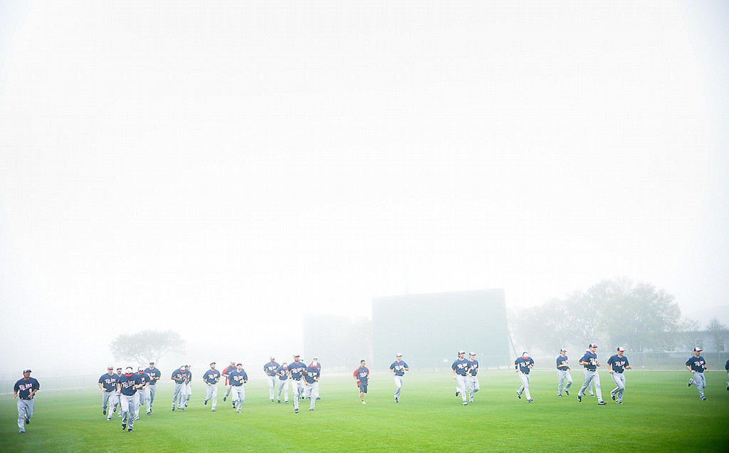 . Twins players warm up in heavy fog during the second day of full team workouts. (Pioneer Press: Ben Garvin)