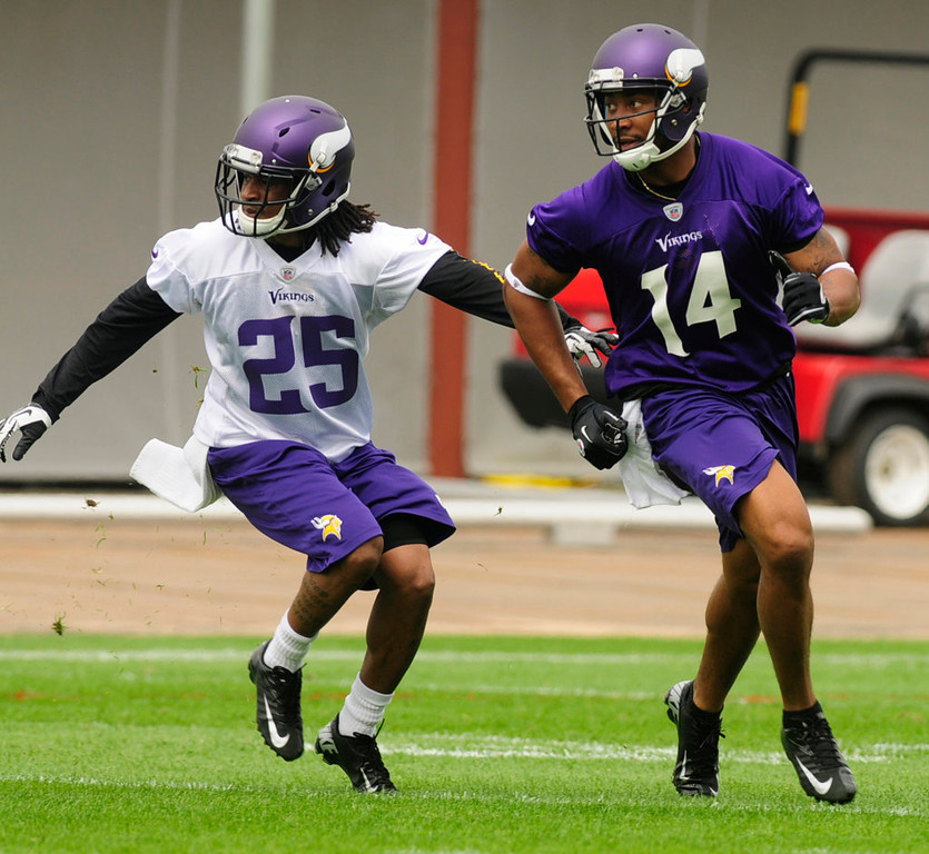 . Vikings rookie cornerback Roderick Williams, left, covers teammate Joe Webb, who is working out as a wide receiver, during organized team activities at Winter Park in Eden Prairie on Wednesday, May 29, 2013.  (Pioneer Press: Scott Takushi)