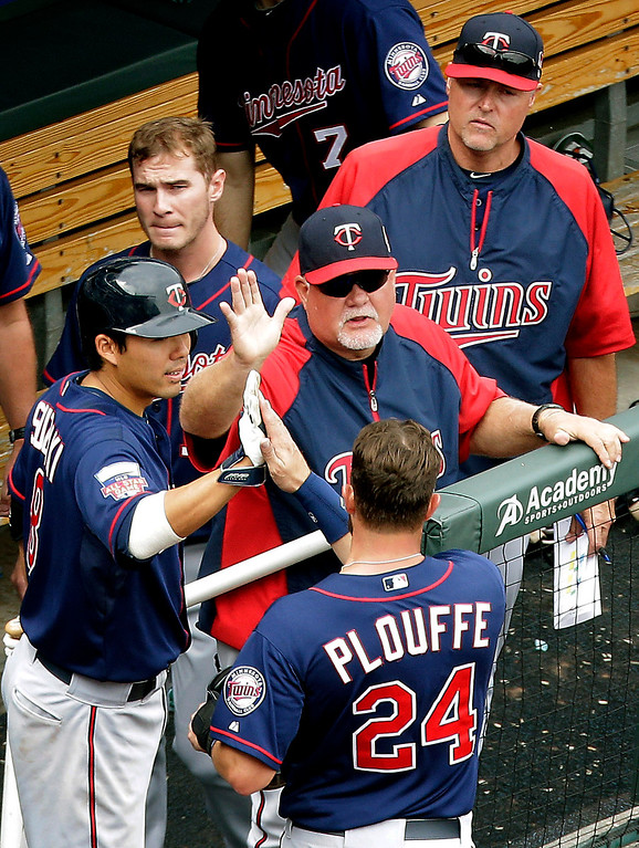 . Minnesota Twins\' Trevor Plouffe (24) celebrates with teammates after scoring on a single hit by Jason Kubel during the seventh inning. (AP Photo/Charlie Riedel)