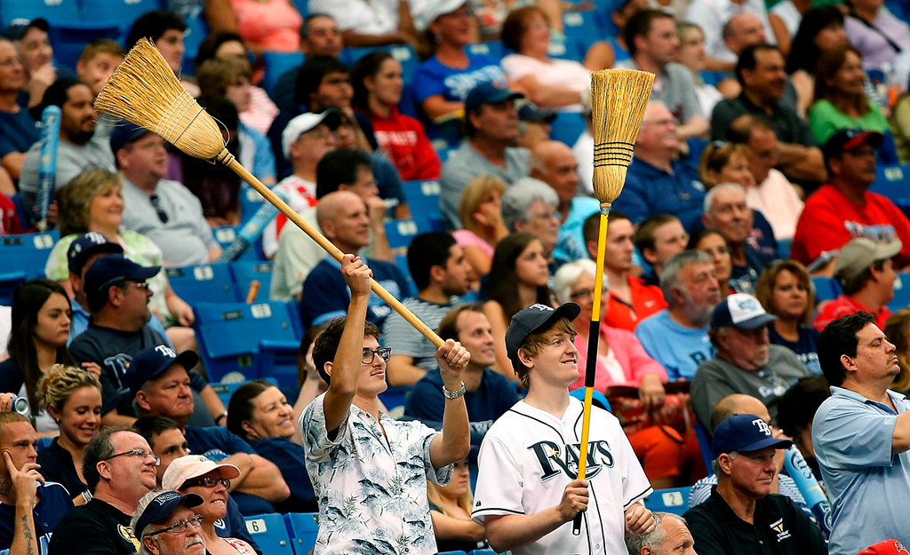 . Fans of the Tampa Bay Rays haul out the brooms following Tampa Bay\'s 4-3 win and series sweep over the Twins. (Photo by J. Meric/Getty Images)
