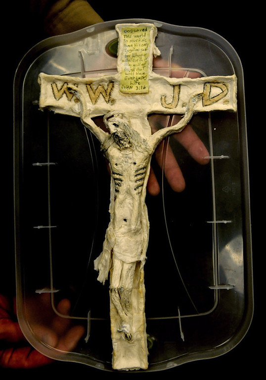 . A foot-tall crucifix was made from paper and toothpaste. (Pioneer Press: Jean Pieri)