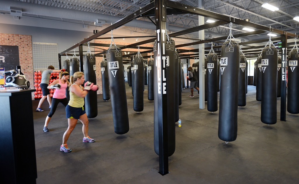. Beginning boxers throw punches in a field of heavy bags during a class at Title Boxing Club, a new specialized gym in Woodbury.   (Pioneer Press: Chris Polydoroff)