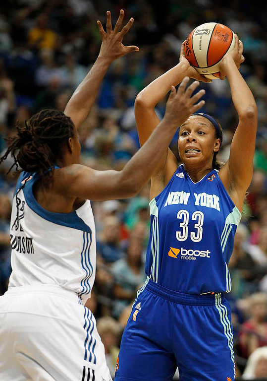 . New York Liberty forward Plenette Pierson looks to make a pass against the defense of Minnesota Lynx forward Rebekkah Brunson  in the first half. (AP Photo/Stacy Bengs)