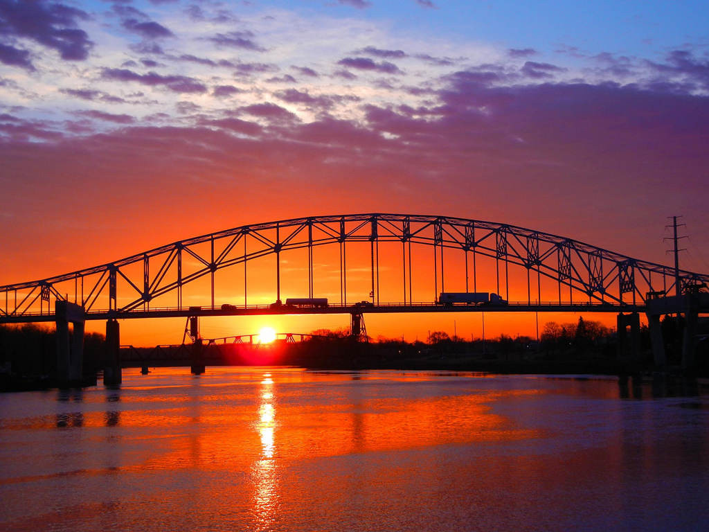 . The sun rises behind the Hastings bridge on March 20, 2012. Photo courtesy of Dave Youngren/Hastings Bridge Watch.