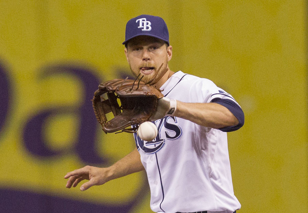 . Ben Zobrist of the Tampa Bay Rays fields a grounder by Justin Morneau of the Minnesota Twins during the first inning. (James Borchuck/Tampa Bay Times/MCT)
