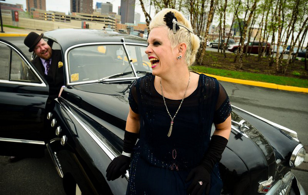 ". �It�s a 1949 Buick Roadmaster. I bought it three years ago and thought, �Why not take it out tonight?� � said Robert Heise of Minneapolis outside this year\'s ""RetroRama\"" fashion show Friday, May 17, at the Minnesota History Center. �The hat I got at Heimie�s (Haberdashery in St. Paul).� Heather Cook of St. Paul, who attended with Heise, said of her outfit, �I got this dress at a thrift store in downtown St. Paul.� (Pioneer Press: Ben Garvin)"