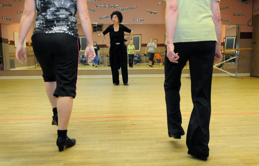 """. Nancy Raddatz, watches as her Adult Jazz-Tap class practices their jazz steps. \""""I use a lot of sound effects when I teach,\"""" she said. (Pioneer Press: Ginger Pinson)"""